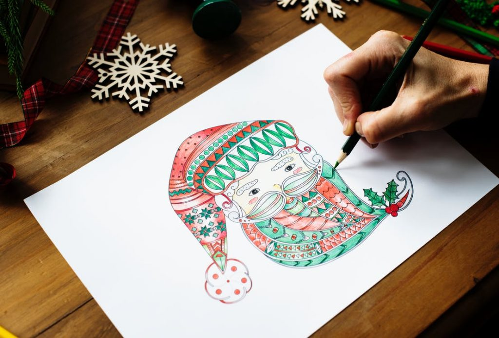 adult coloring a christmas picture